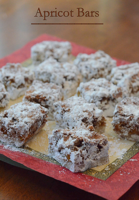 Apricot Bars dusted with powdered sugar on a napkin.