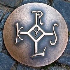 The signature seal of Charlemagne is used to indicate the walking route of sights in the old town of Aachen.