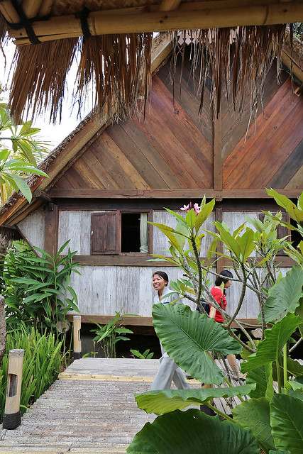 The spa features antique huts transplanted from Sumatra