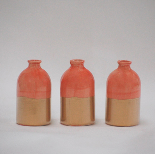 orange and bronze vases