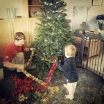 George helping to decorate the Christmas tree