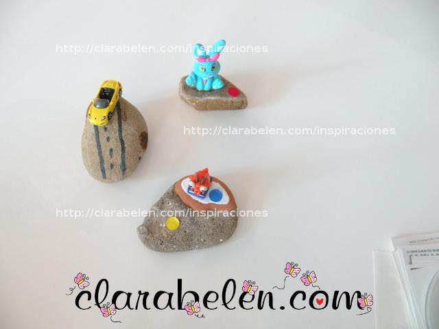 Pisapapeles para el dia del padre hecho con los niños con piedras y juguetes reciclados