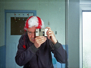 reflected self portrait with Konica AA-35 camera and inside out wig