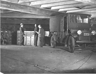 Photograph of Workers Moving U.S. Food Administration Records from White House Garage to the National Archives Building , 12/21/1935