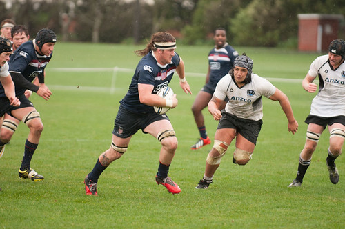 A Collegiate All-Amercan rugby player breaks away.