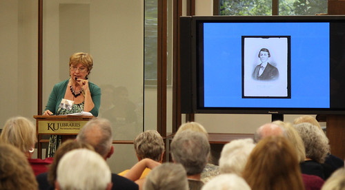 Curator of Collections Sheryl Williams speaks to the audience about Quantrill's Raid