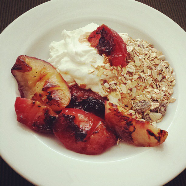 Cool Greek yogurt, muesli, and warm grilled peaches & plums. This is all the laboring I'm doing today.