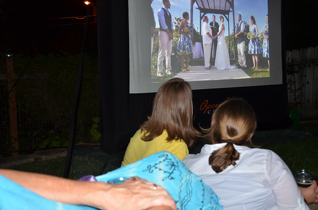 A slideshow being viewed at a wedding.