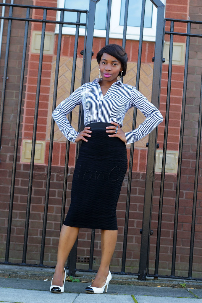 monochrome vertical stripe shirt, dangling earrings, ring, and a black pencil skirt, monochrome look, monochrome outfit