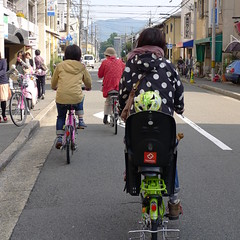 Kyoto Mother Cycling with child on back