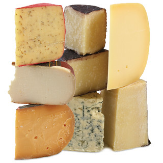 a stack of nine different kinds of cheese
