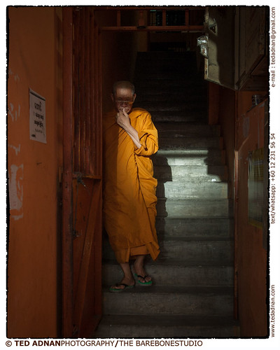 A Buddhist monk descending a flight of stairs in downtown Kuala Lumpur