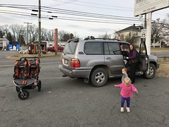 The twins and Kate get out the truck to take a stroller walk to dinner