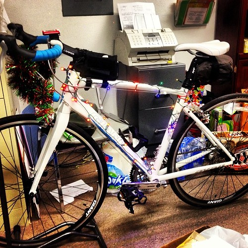 Decorating my bike for tonight! #christmas #bike #christmaslights #rolling