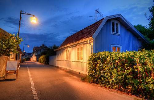 street city trees houses windows roof night clouds landscape lights town wooden shadows cloudy sweden dusk rustic pipe advertisement commercial sverige lamps pastoral asphalt bushes idyllic hdr antennas hedges trosa östralånggatan ågårdensrestaurang
