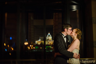 Bride and groom kiss at St Paul History Center wedding