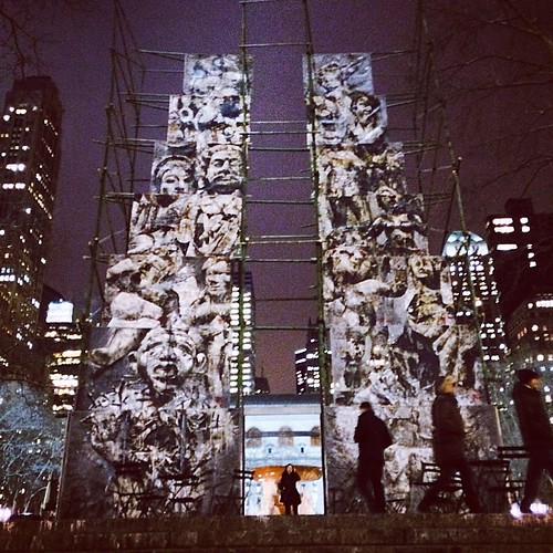 In Bryant Park: Analogia at night with the Josephine Shaw Lowell MemorialFpuntain glowing at the back and the New York Public Library standing guard in the distance.  Even more imposing at night and viewed up close by the steps.  Art installation by Ben T