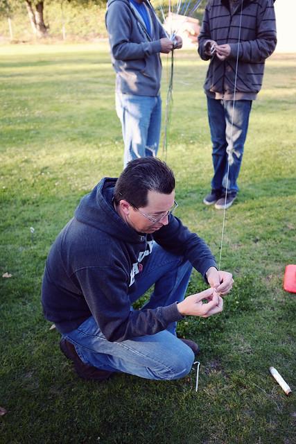 Jeremy tying balloons