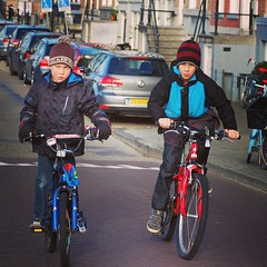 Two boys cycling in Amsterdam