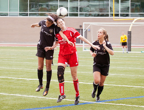 Bronwyn Craswford goes up for header with Heat (May 26, 2013 Allen Douglas)