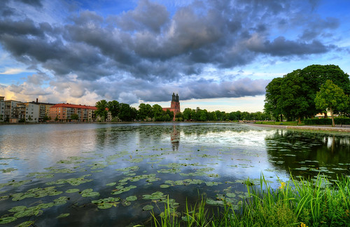 trees houses sky lake clock church grass clouds reflections landscape day cloudy sweden towers sverige hdr eskilstuna waterscape stadsparken eskilstunaån nybron strömsholmen klosterskyrka
