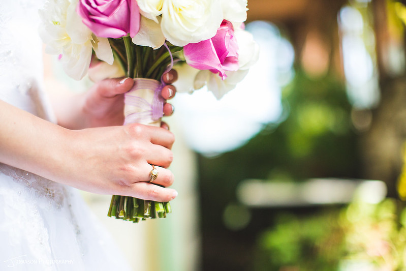 Bride with bouquet ring