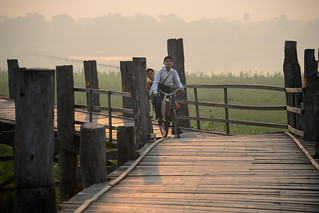 Children riding a bike - U Bein bridge - Amarapura