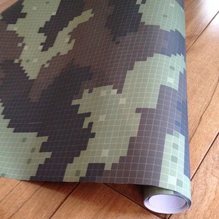 Pixelated camo wrap by paper_canoe. Perfect for my 8-yr old son who's in love with Minecraft. Available for sale on Spoonflower.com