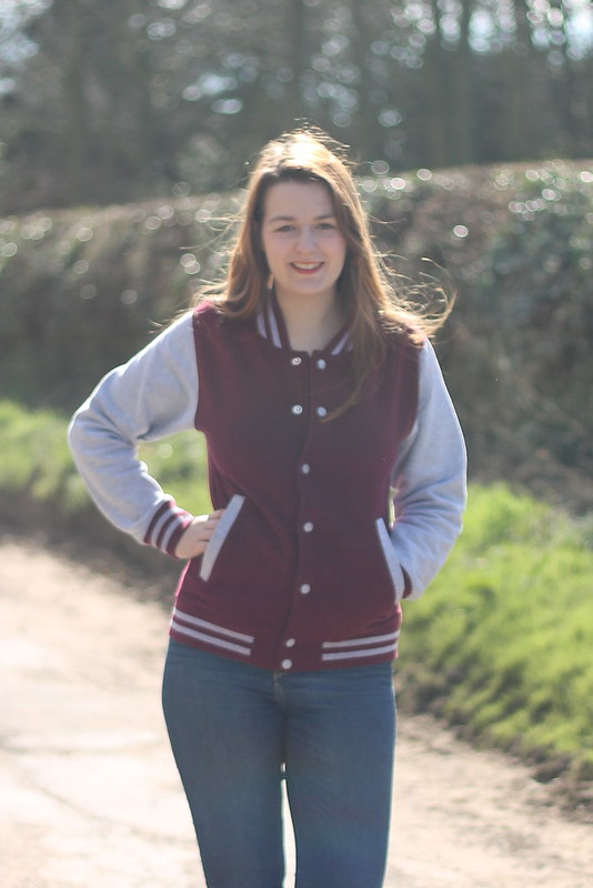Baseball jersey outfit with jeans