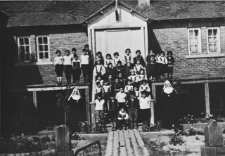 Children and nuns in front of the Indian Residential School, Maliotenam, Quebec, circa 1950 / Enfants et religieuses devant le Pensionnat indien de Maliotenam (Québec), vers 1950