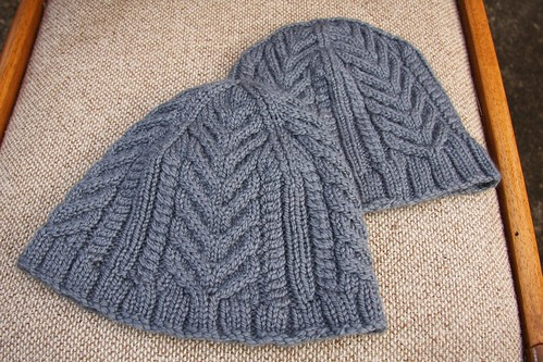 Two cabled hats