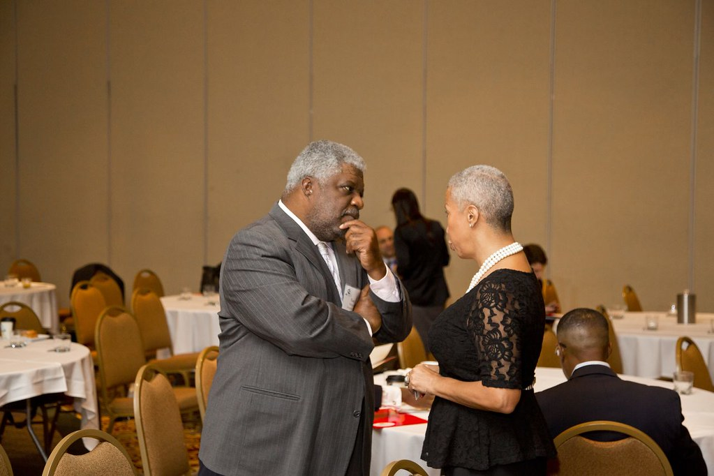 Attendee engaging with presenter.