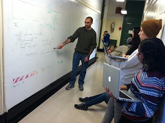 Mr. Pascual, teaching a computer science workshop on the whiteboard walls