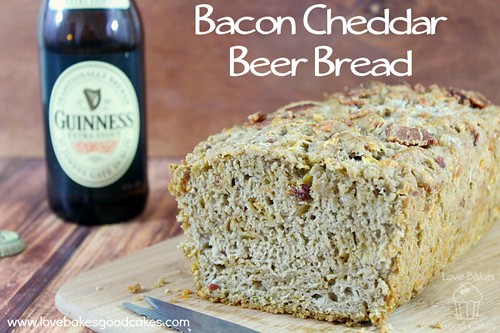 Bacon Cheddar Beer Bread loaf close up with a bottle of Guinness.