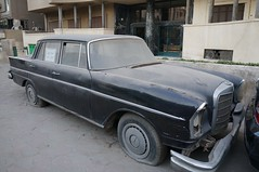 compact car(0.0), convertible(0.0), automobile(1.0), automotive exterior(1.0), vehicle(1.0), mercedes-benz w108(1.0), mercedes-benz(1.0), full-size car(1.0), mercedes-benz w111(1.0), antique car(1.0), sedan(1.0), classic car(1.0), vintage car(1.0), land vehicle(1.0), luxury vehicle(1.0),