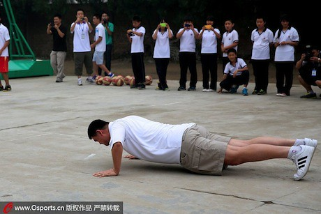 June 30th, 2013 - Yao Ming does push-ups after his team loses a bet on which team could make the most layups.