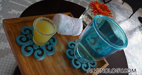 Citrus welcome drink and a warm towel to freshen me up before my massage session
