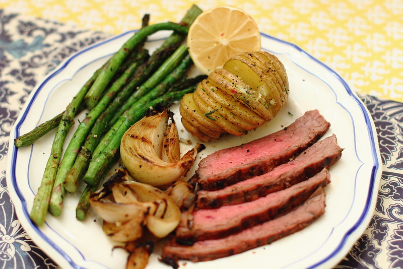 Sunday Night Dinner: Balsamic Flank Steak and Onions with Accordion Potatoes and Grilled Asparagus