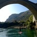 Small photo of SUP under the Stari Most