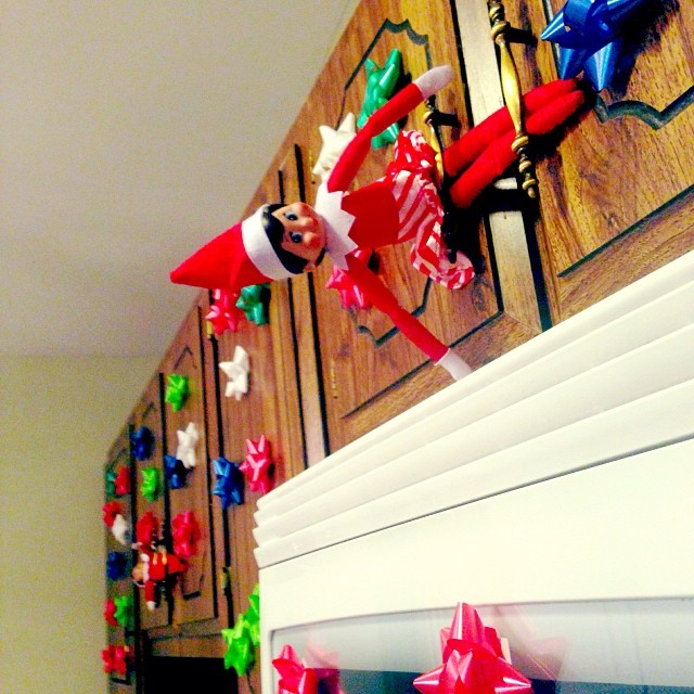 The darn elves are making Mommy mad!! They got in the kitchen and put bows evvverywhere!!! The kids were worried Mom would put the elves in time out so they got all the bows down with a back scratcher!! Lol! Talk about team work!! #hisugarplumelffun
