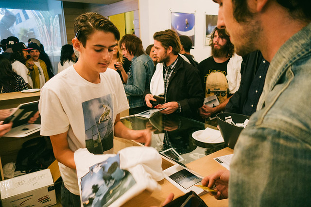 Jacob Messex selling zine to Eric McHenry