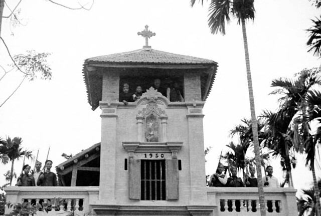 North Vietnam 1950 - People standing in tower of newly built Catholic church in Vĩnh Yên