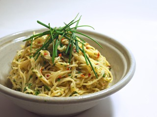 spaghetti with chives and fresh red chili pepper