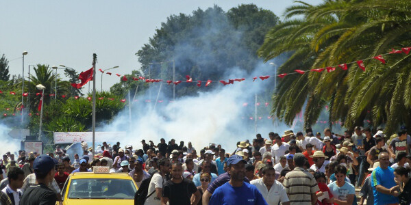 Protesters flee tear gas near the National Constituent Assembly building in Bardo, July 27, 2013. Photo credit: Tristan Dreisbach, Tunisia Live