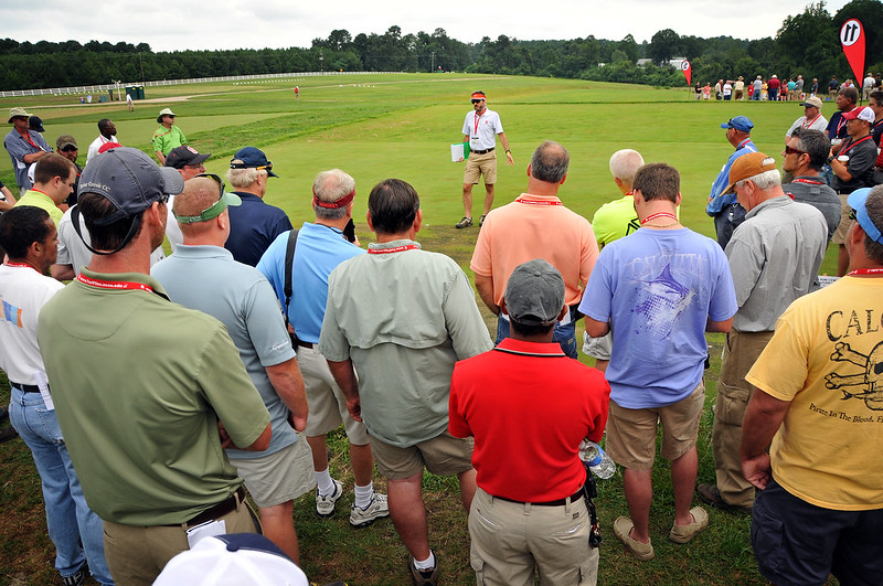 Turfgrass Field Day attendees gather around Fred Yelverton as he leads the topic 'New Herbicide Technologies for Turfgrass Weed Management.'
