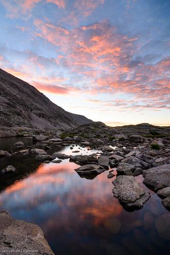 usa sun mountain mountains color colour reflection water clouds sunrise landscape dawn colorado unitedstates nederland northamerica indianpeakswilderness upperbluelake