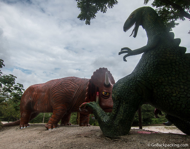A Triceratops attacks a Godzilla-looking T-Rex