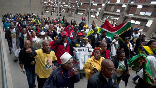 Crowds march during a memorial for former ANC leader and President Nelson Mandela. by Pan-African News Wire File Photos
