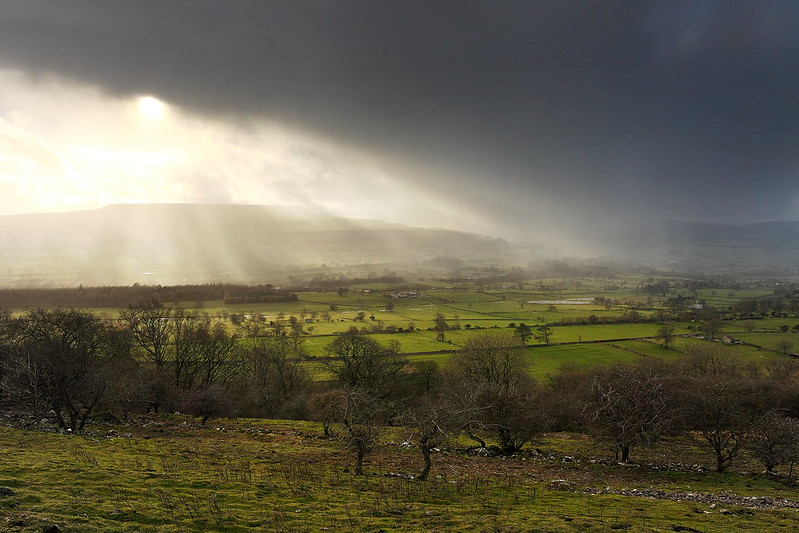 A heavy shower near Penhill/Pen Hill in Wensleydale, Yorkshire Dales.
