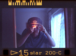 reflected self-portrait with Kodak Advantix F350 camera and Icelandic hat